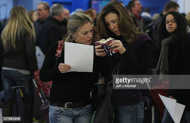 Passengers wait in the airport as they face delays to their flights following disruption due to snow at Edinburgh Airport on December 19 2010 in...