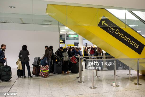 Passengers wait in the South Terminal building at London Gatwick Airport after flights resumed today on December 21 2018 in London England...