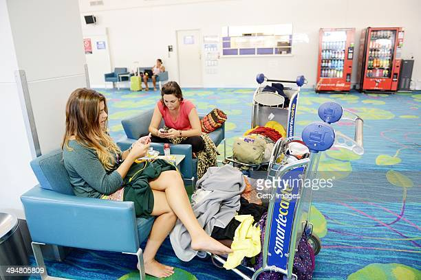 Passenger's wait inside Darwin airport on May 31 2014 in Darwin Australia Flights in and out of Darwin have been suspended as volcanic ash from Mount...