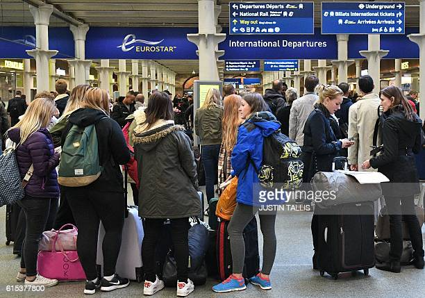 Passengers wait near the International Departures area at the Eurostar terminal at London St Pancras train station in London on October 18 2016...