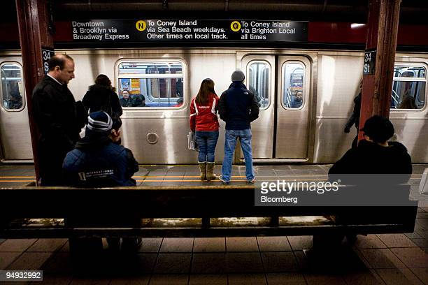 Passengers wait on a platform at the 34th Street subway station in New York US on Thursday Nov 20 2008 The Metropolitan Transportation Authority the...