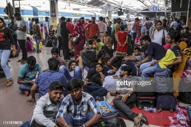 Passengers wait on a platform at the Bhubaneshwar Railway Station after Cyclone Fani passes in Bhubaneshwar Odisha India on Sunday May 5 2019...