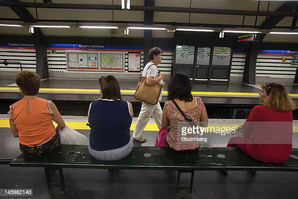 Passengers wait on a platform at the Cuatro Caminos metro station in Madrid Spain on Friday June 8 2012 Spain is poised to become the fourth of the...