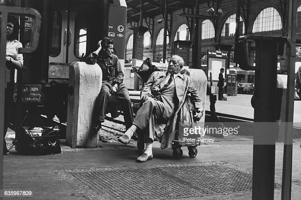 Passengers wait on a train platform at Gare du Nord.
