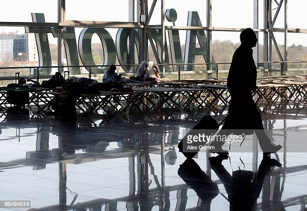 Passengers wait on camp beds at the departure hall of Frankfurt International Airport on April 16 2010 in Frankfurt am Main Germany Clouds of ash...