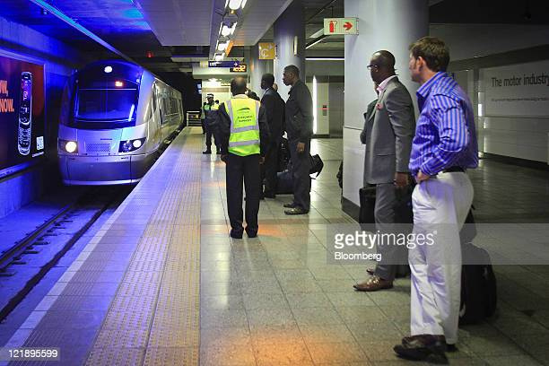 Passengers wait on the platform of Gautrain's Sandton mass transit rail station in Johannesburg South Africa on Monday Aug 22 2011 South Africa...