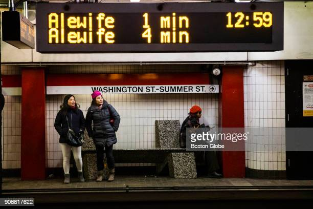 Passengers wait on the platform under countdown clocks for a Red Line train at the Downtown Crossing MBTA station in Boston on Jan 18 2018 The MBTA...