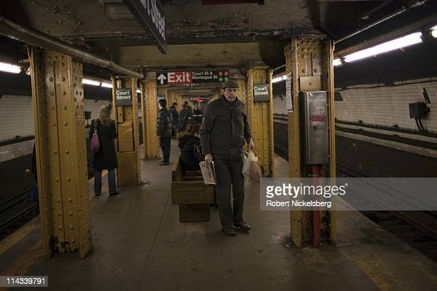 Passengers wait on the subway platform February 28, 2011 in Brooklyn, New York. In 2009, the New York City Subway delivered nearly 1.6 billion rides,...