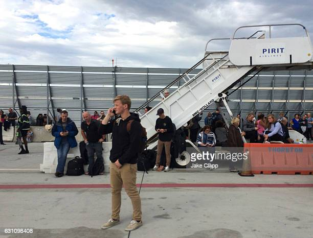 Passengers wait on the tarmac of Fort LauderdaleHollywood International airport after a shooting took place near the baggage claim on January 6 2017...