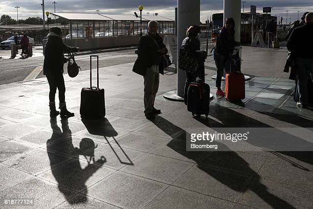 Passengers wait outside the checkin area at London Stansted Airport operated by Manchester Airports Group in Stansted UK on Friday Oct 28 2016...
