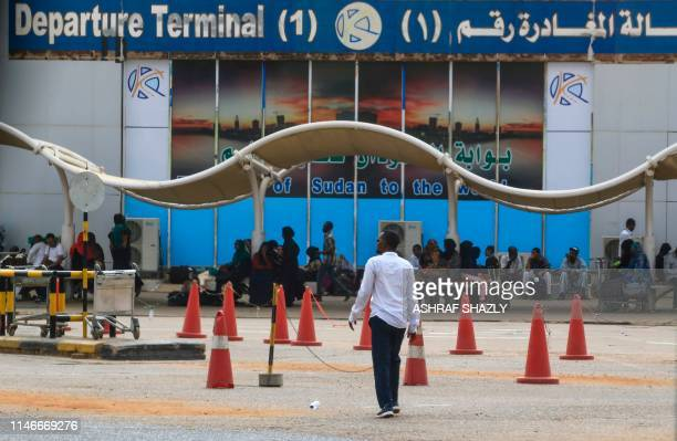Passengers wait outside the departure terminal at Khartoum airport on May 28, 2019 as aviation professionals take part in a two-day national strike...