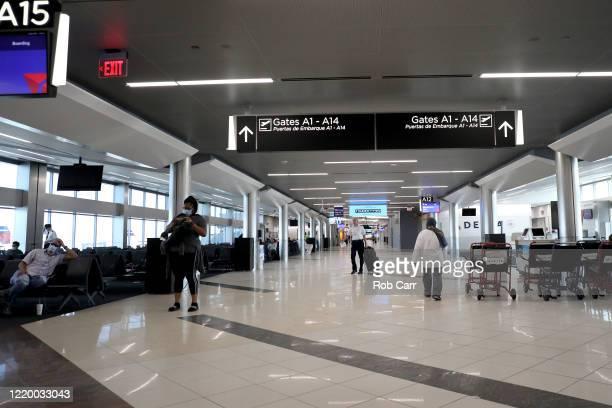 Passengers wait to board a Baltimore Maryland bound Delta flight from HartsfieldJackson Atlanta International Airport on April 20 2020 in Atlanta...