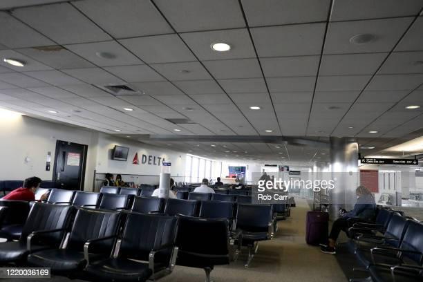 Passengers wait to board a flight to Atlanta Georgia at Baltimore/Washington International Thurgood Marshall Airport on April 20 2020 in Linthicum...