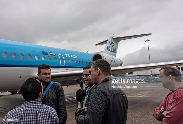 Passengers wait to board a KLM Fokker F70 at Schiphol International Airport in Amsterdam Netherlands 26 April 2015 Amsterdam is one of the most...