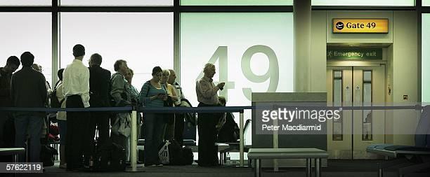 Passengers wait to board a low cost flight from Stansted airport to Dinard in France on May 15, 2006 in London. Low cost airlines are increasing...