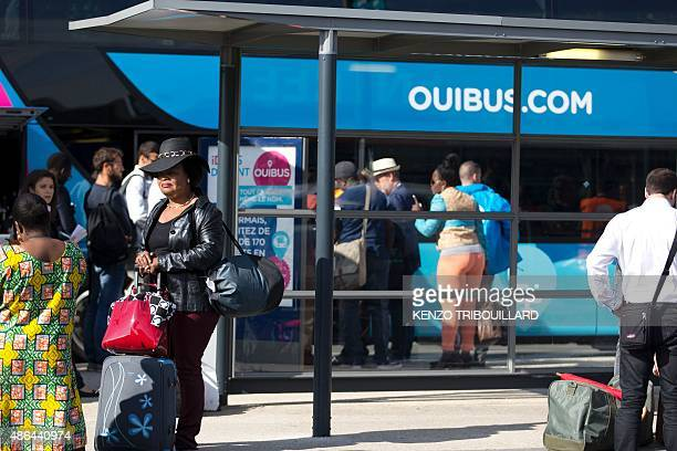 Passengers wait to board a Ouibus at Bercy bus station in Paris on September 4 on the day of the official launch of Ouibus, a long-haul coach...