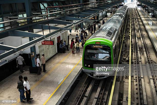 Passengers wait to board a train at Mantri Sampige Square Metro station operated by Bangalore Metro Rail Corp in Bengaluru India on Sunday May 3 2015...