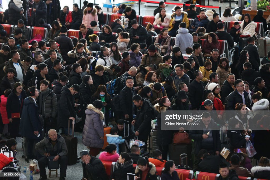 Passengers wait to board the train as they started to return to school and work at Harbin West Railway Station on February 20, 2018 in Harbin, Heilongjiang Province of China. Harbin West Railway Station sees travel peak on the fifth day of the Lunar New Year.