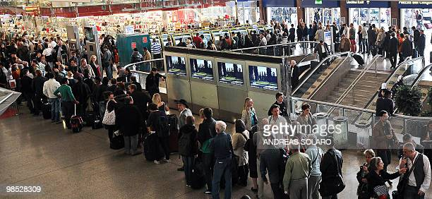 Passengers wait to buy tickets at Termini central train station in Rome on April 18 2010 Air traffic remained seriously disrupted across Europe as a...