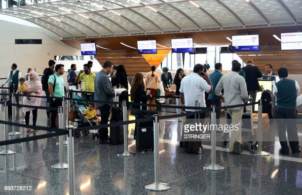 Passengers wait to checkin at the Hamad International Airport in Doha on June 7 2017 A ban on Qatari flights imposed by Saudi Arabia and its allies...