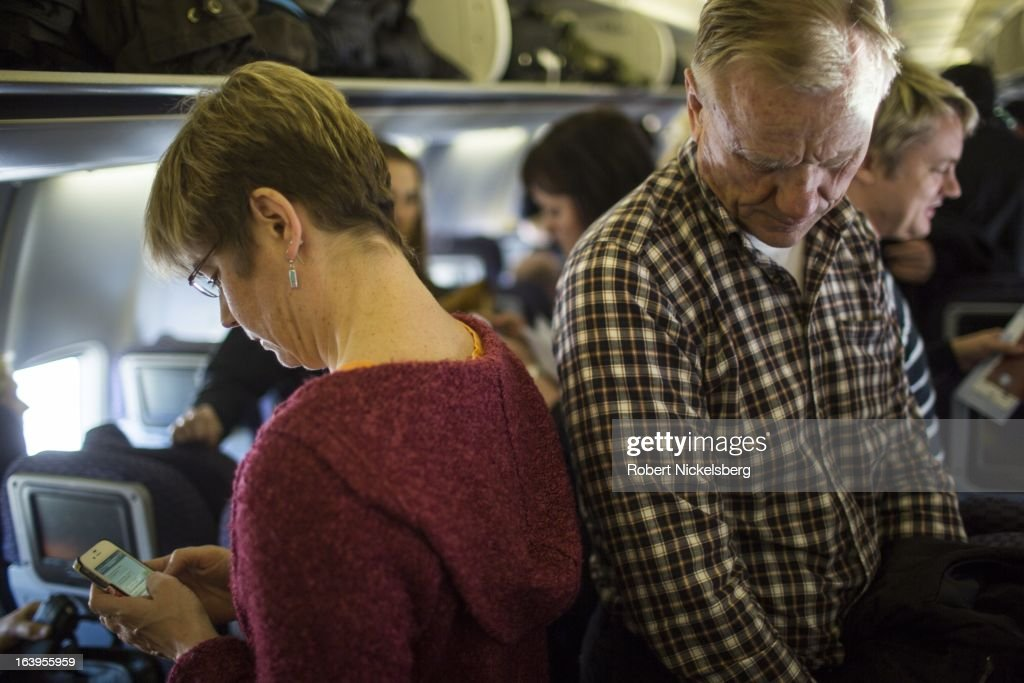 Passengers wait to exit an United Airlines plane from Oslo, Norway at the Newark Liberty International Airport March 9, 2013 in Newark, New Jersey.