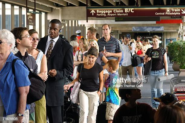 Passengers wait to go through security and board a flight at Philadelphia International Airport August 10 2006 in Philadelphia Pennsylvania The US...