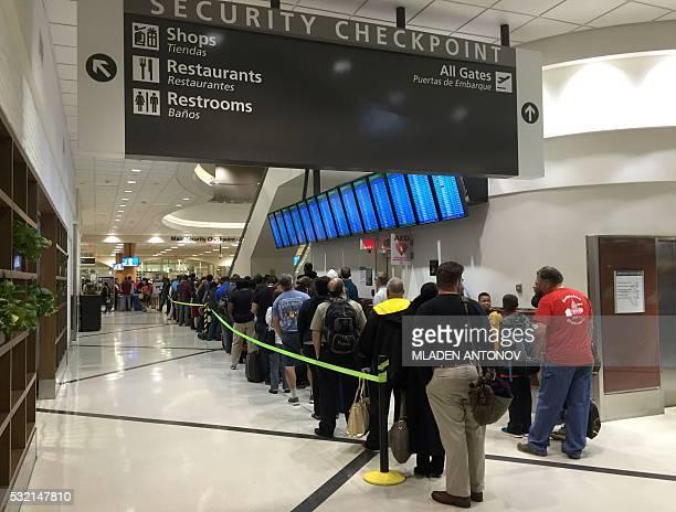 Passengers wait to go through security at the north terminal of the HartsfieldJackson Atlanta International Airport in Atlanta Georgia on May 17 2016...