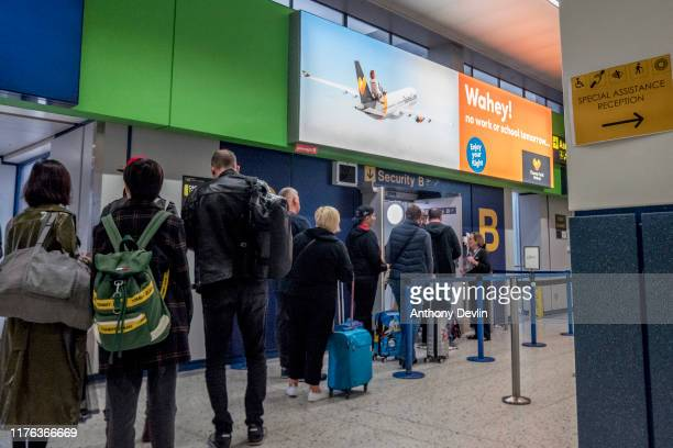 Passengers wait to go through to the Thomas Cook checkin desks at Manchester Airport on September 22 2019 in Manchester EnglandThomas Cook is holding...