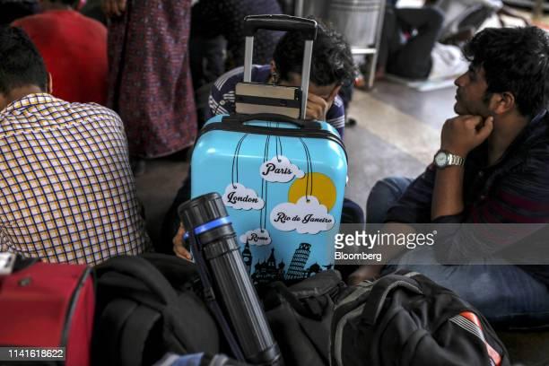 Passengers wait with their luggage at the Bhubaneshwar Railway Station after Cyclone Fani passes in Bhubaneshwar Odisha India on Sunday May 5 2019...