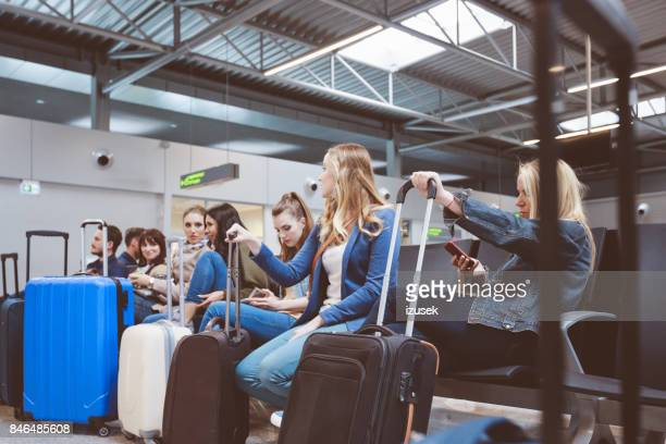 passengers waiting at airport lounge - flying stock photos and pictures