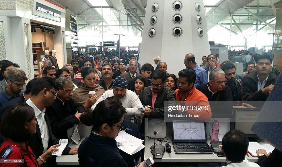 Passengers waiting at IGI Airport as their flights delay due to dense fog on December 2 2016 in New Delhi India The dense fog that has engulfed...