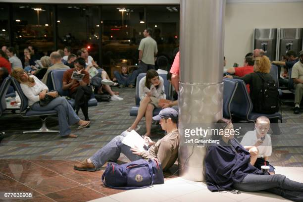 Passengers waiting for a delayed Delta Airlines flight at HartsfieldJackson Atlanta International Airport