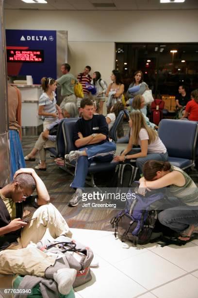 Passengers waiting for a delayed Delta Airlines flight at HartsfieldJackson Atlanta International Airport