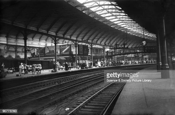 Passengers waiting for a train at Newcastle station 26 July 1948 The passengers were probably taking a day trip At this time it was becoming common...