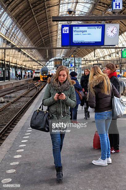 Passengers waiting for the train in Amsterdam Central Station