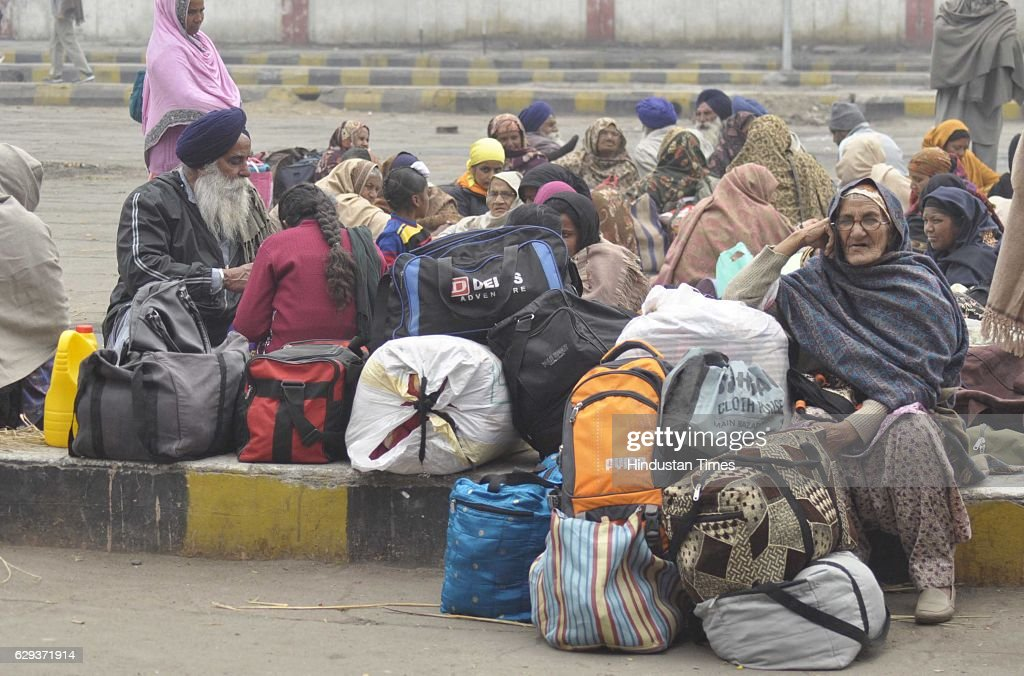 Passengers waiting for trains as most of the trains are late and some are cancelled due to the fog at railway station on December 12 2016 in...