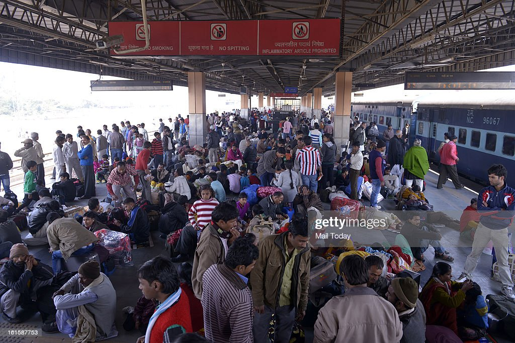 Passengers waiting for trains at Delhi Anand Vihar Station in New Delhi.
