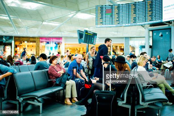 Passengers waiting in departures