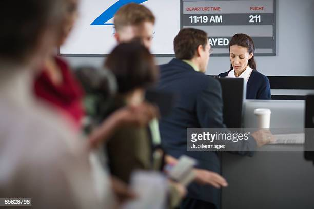 Passengers waiting in line at airport