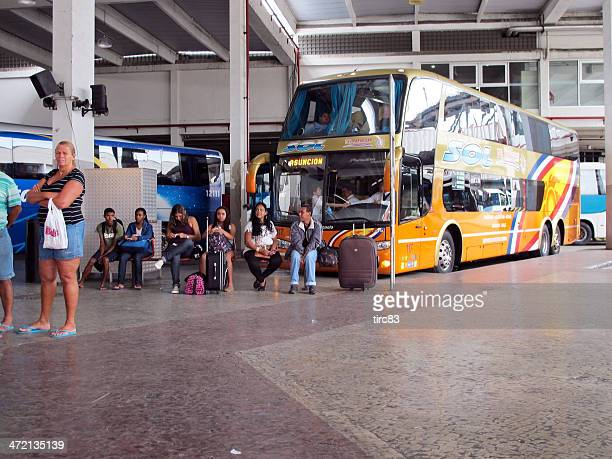 Passengers waiting outside a Brazilian coach station