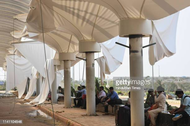 Passengers waiting outside as the Biju Pattanayak International airport after the Cyclone Fani on May 4 2019 in Bhubaneshwar India At least 12 people...