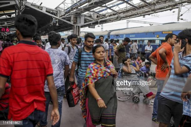 Passengers walk along a platform at the Bhubaneshwar Railway Station after Cyclone Fani passes in Bhubaneshwar Odisha India on Sunday May 5 2019...