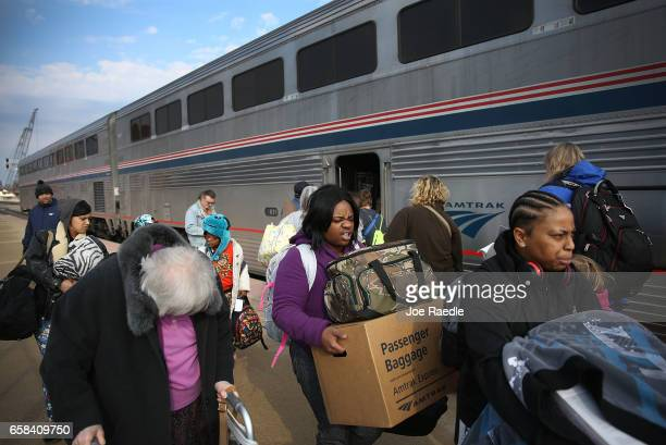 Passengers walk along Amtrak's California Zephyr as it stops at a station during its daily 2438mile trip to Emeryville/San Francisco from Chicago...