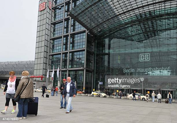 Passengers walk around the Berlin Hauptbahnhof in Germany, on May 20, 2015. German rail travel was paralysed Wednesday by an open-ended strike, It is...