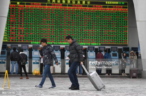 Passengers walk at Lanzhou Railway Station on January 3 2018 in Lanzhou Gansu Province of China Train tickets for Chinese Spring Festival travel rush...