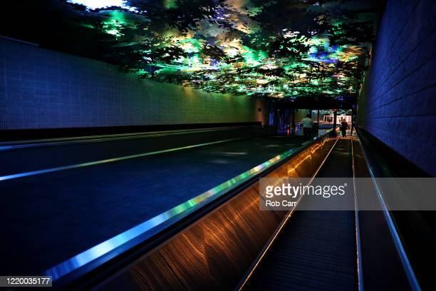 Passengers walk between terminals at HartsfieldJackson Atlanta International Airport on April 20 2020 in Atlanta Georgia The airline industry has...