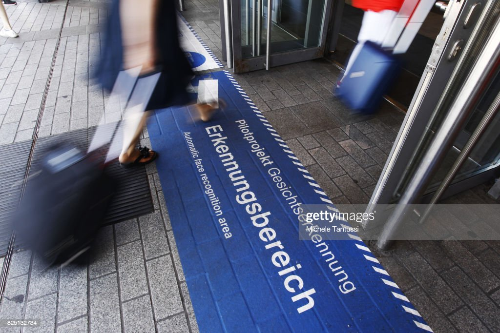 Passengers walk by a security sign warning for a Face recognition area at the Suedkreuz train station on August 1, 2017 in Berlin, Germany. German federal police have started a six-month test at the Suedkreuz station of facial recognition software. Over the past weeks police have asked for volunteers, passengers who frequently use the station, to allow themselves to be photographed and participate in the project. Approximately 275 people responded. The test project will run for the next six months and is designed to help authorities in the fight against terrorism.