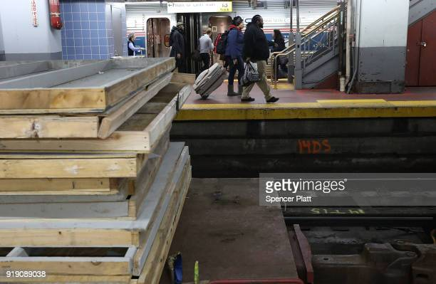 Passengers walk by construction at New York's Pennsylvania Station on February 16 2018 in New York City Amtrak gave a media tour on Friday to show...