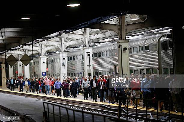 Passengers walk down the platform inside Union Station in Chicago Illinois US on Thursday Oct 8 2015 The head of Amtrak warned Congress that some...