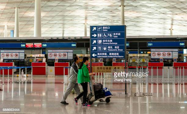 Passengers walk in Terminal 3 of Beijing Capital International Airport According to China CAAC China will build three worldclass airport clusters in...